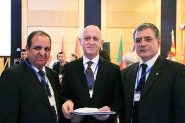 Ибод Рахимов (в центре) на встрече с Председателем (слева) и Генеральным секретарем (справа) ПАС